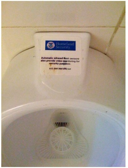 GearDiary Probably Fake (but funny) Houston Airport Homeland Security Urinal Monitor sticker