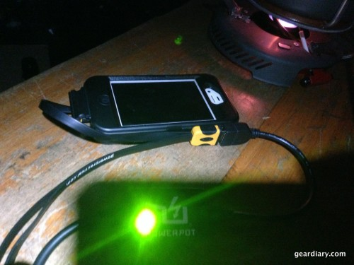 PowerPot's green indicator light letting my know my iPhone is ready to charge.