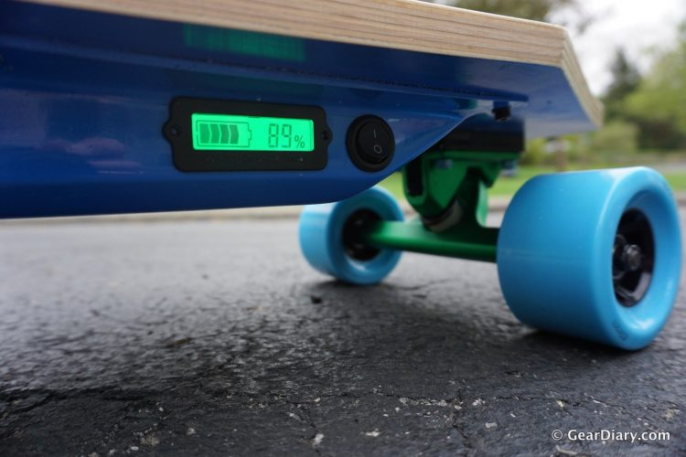 Long Haired Boy Makes a Fine Electric Skateboard