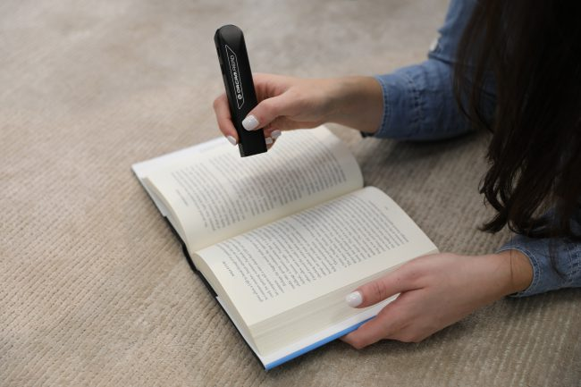OrCam Read Is the Digital AI Assistive Reading Device We've Been Waiting For